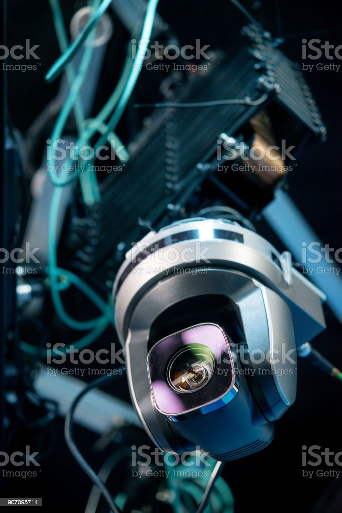 Digital suspended video camera under the ceiling on television stock photo