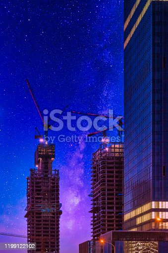 464482634 istock photo Digital Synthesis, Tower Crane and Starry Sky 1199122102