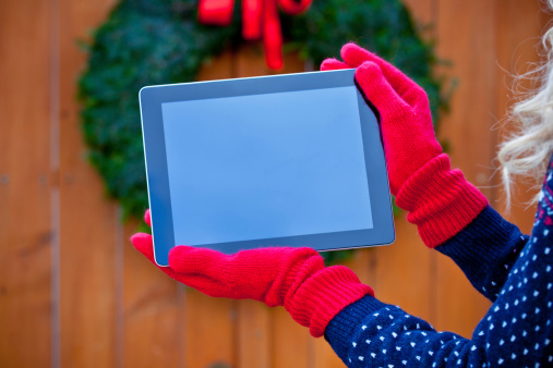 Digital Tablet Against Christmas Ornaments Stock Photo - Download Image Now
