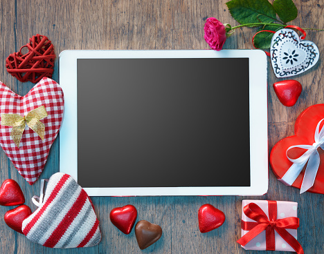 Digital tablet and different hearts for Valentine's day