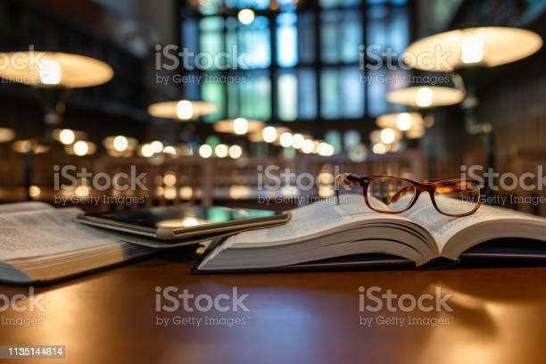 Digital tablet and eyeglasses on books in public library picture id1135144614?b=1&k=6&m=1135144614&s=612x612&h=iabqbjkq8l7sro zud3laylamuwlrku hublyyo4ufo=