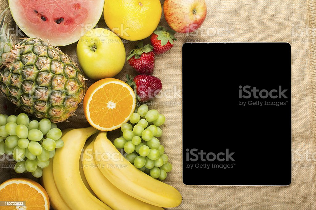 Digital tablet and frame of fresh fruits royalty-free stock photo