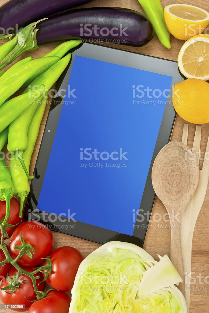 Digital tablet and freshness vegetables royalty-free stock photo