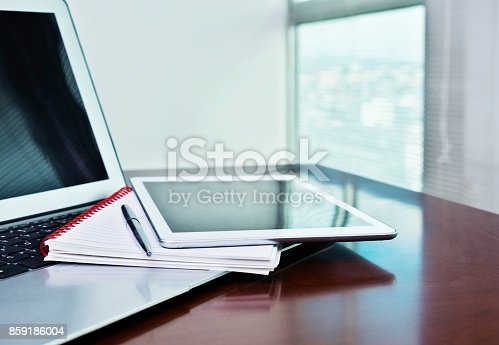 859186006 istock photo Digital tablet and note pad on computer keyboard 859186004