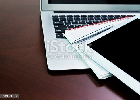 istock Digital tablet and note pad on computer keyboard 859186130