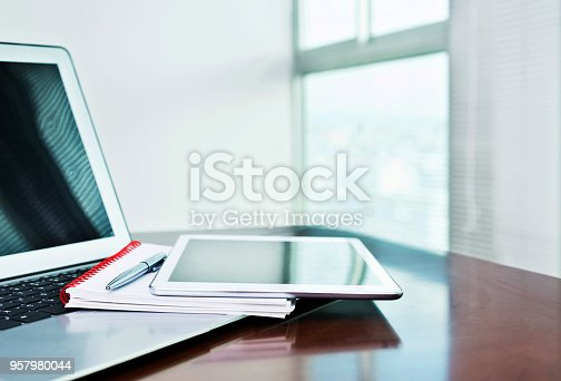 859186006 istock photo Digital tablet and note pad on computer keyboard 957980044