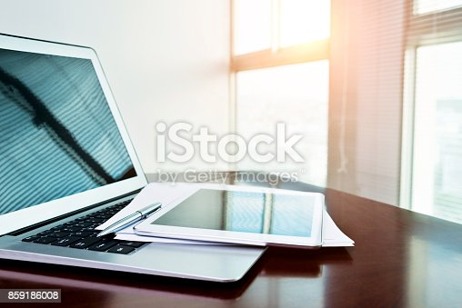 859186006 istock photo Digital tablet and paper on computer keyboard 859186008