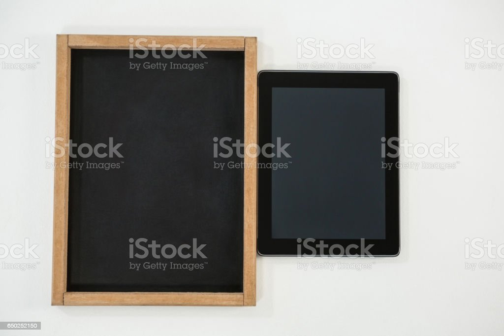 Digital tablet and slate on white background stock photo