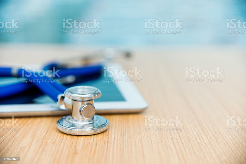 Digital tablet and stethoscope stock photo