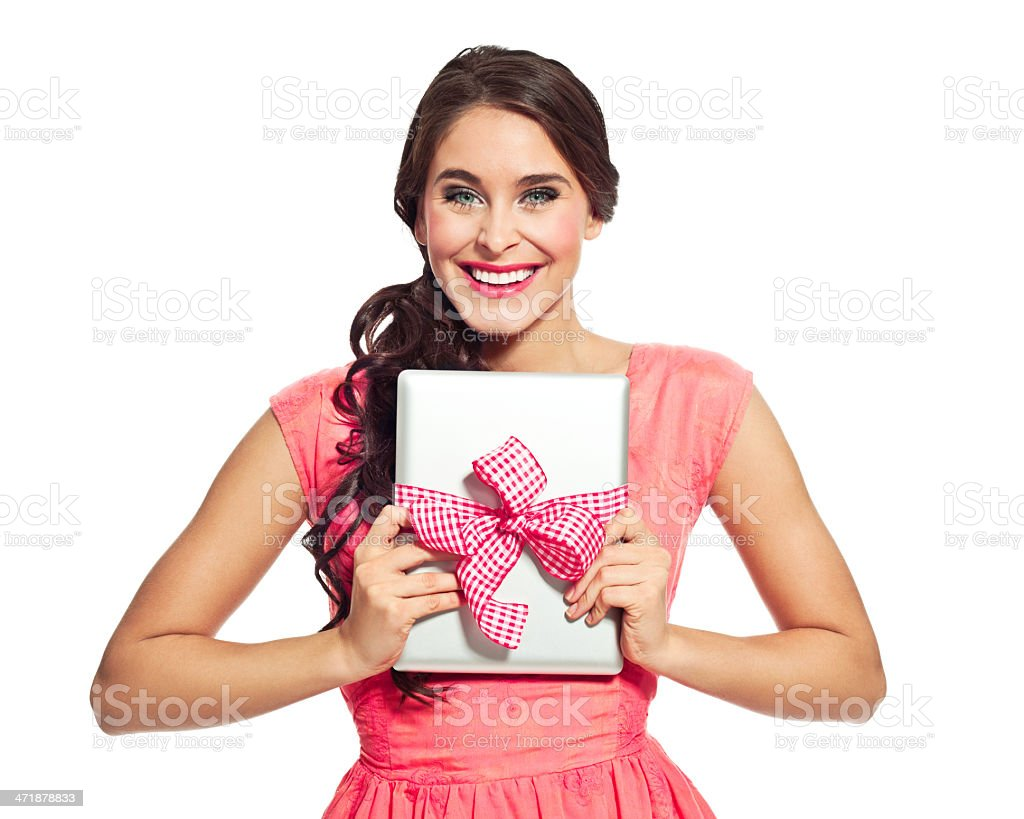 Digital tablet as a gift Portrait of excited young woman holding a digital tablet tied with ribbon and laughing at the camera. 20-24 Years Stock Photo