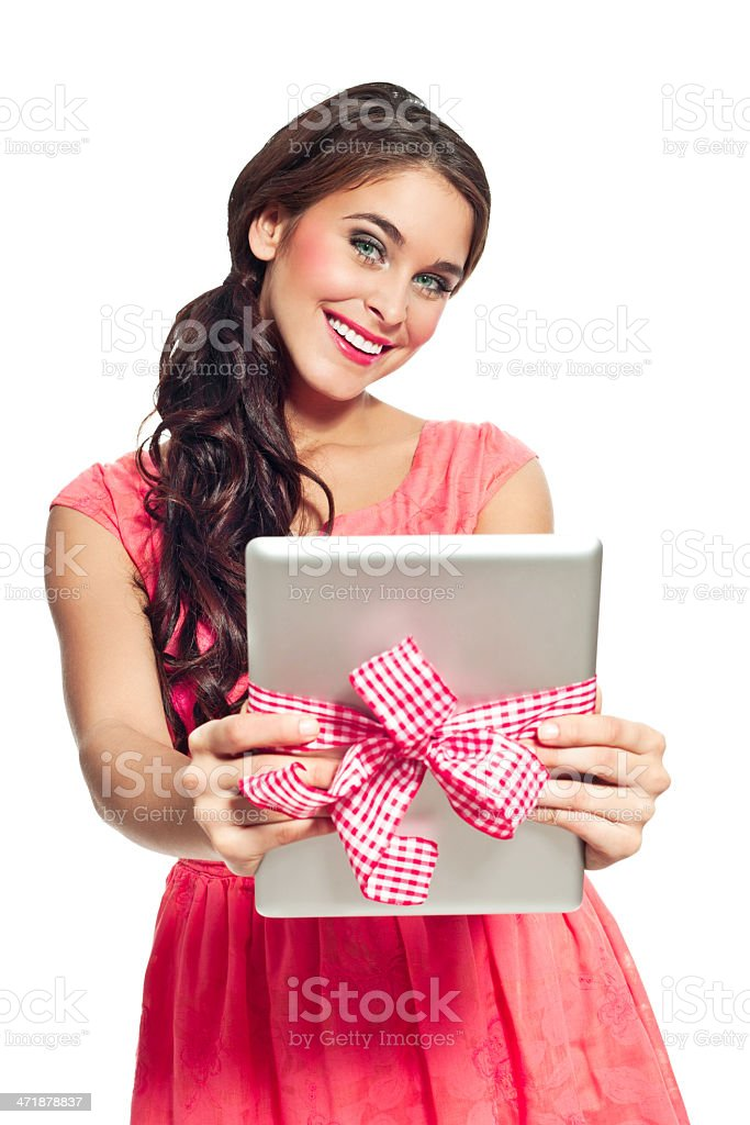 Digital tablet as a gift Portrait of beautiful young woman holding a digital tablet tied with ribbon and smiling at the camera. 20-24 Years Stock Photo