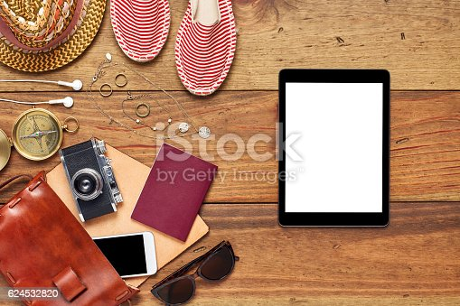 941183588 istock photo Digital tablet by beach accessories flat lay on wooden floor 624532820