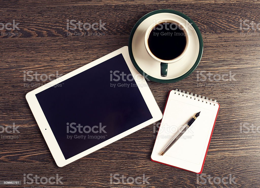 Digital tablet computer with note paper and cup of coffee stock photo