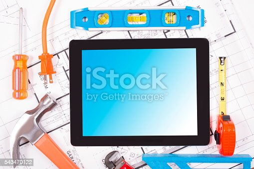istock Digital tablet.  Constrution, DIY tools lie on home blueprints, plans. 543470122