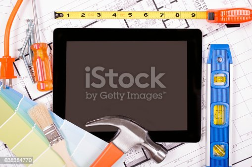 istock Digital tablet.  Constrution, DIY tools lie on home blueprints, plans. 638384770