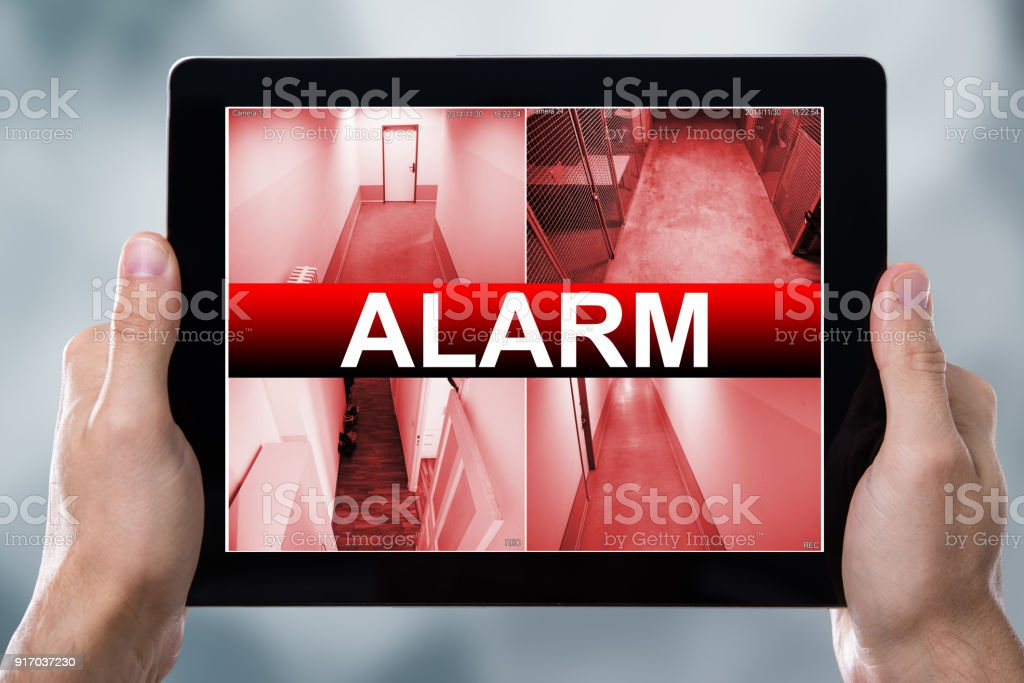 Digital Tablet Displaying Alarm Text stock photo