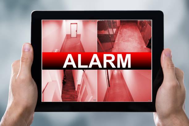 Digital Tablet Displaying Alarm Text stock photo