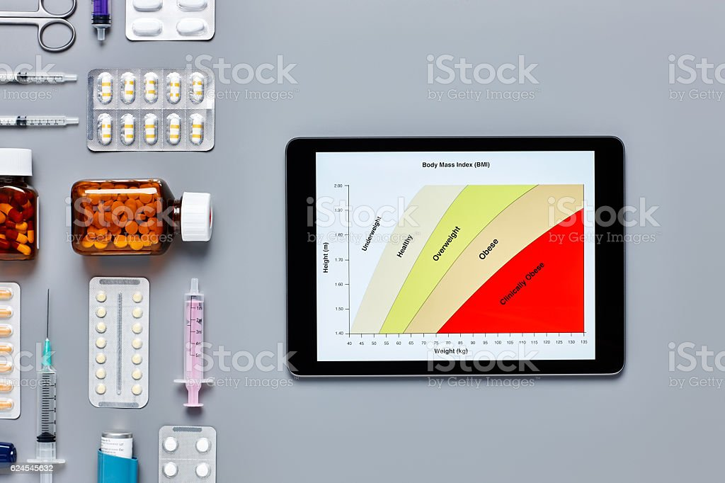 Digital tablet displaying body mass index by various medical equipment stock photo
