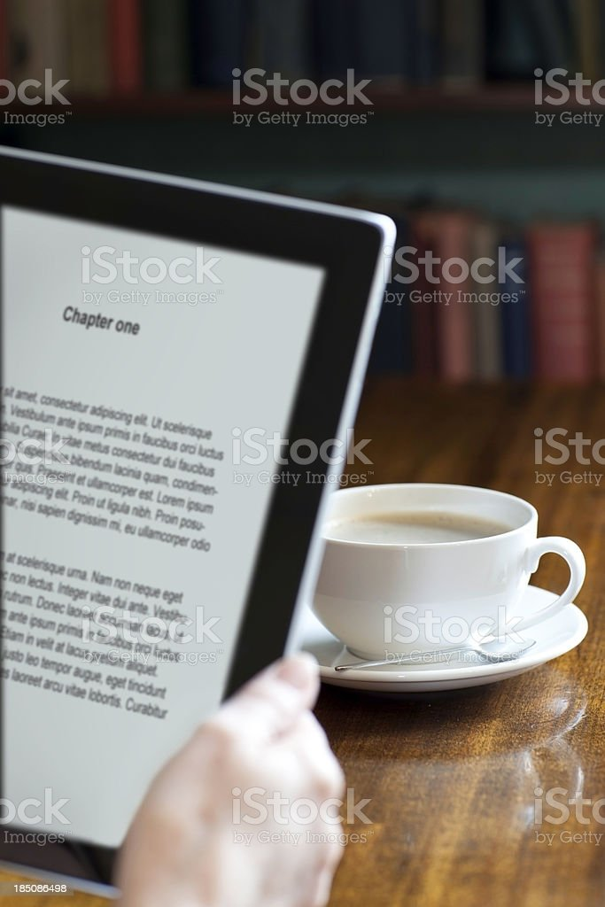 Digital tablet in a library or book shop royalty-free stock photo