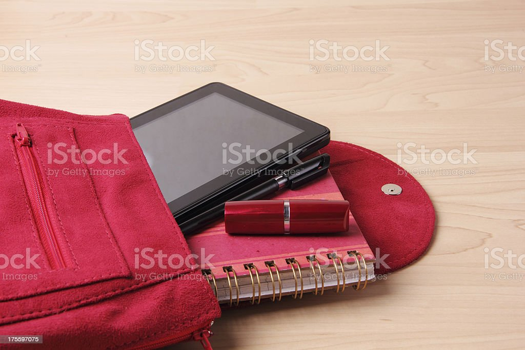 Digital Tablet in  Woman's Bag Backpack royalty-free stock photo