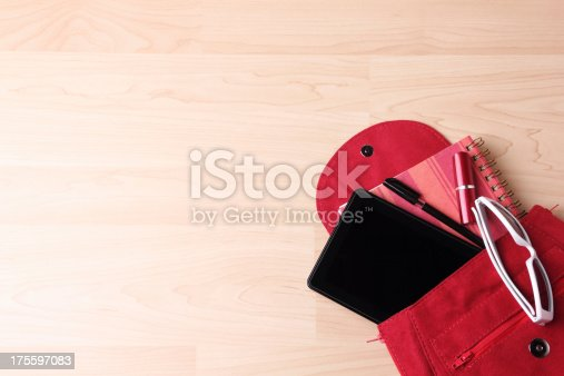 istock Digital Tablet in  Woman's Bag Backpack 175597083