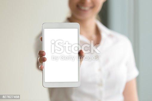 863476202istockphoto Digital tablet mockup screen in female hands, closeup, copy space 827627458