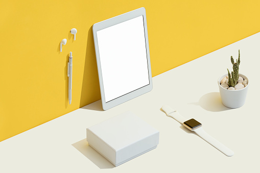 Personal accessories with white blank screen digital tablet mockup, template flat lay on yellow and white background.