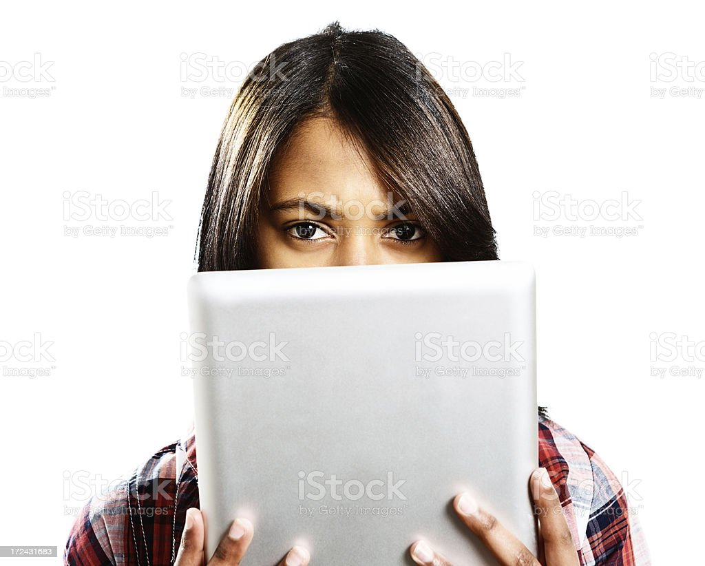 Digital tablet obscures the face of serious brunette royalty-free stock photo