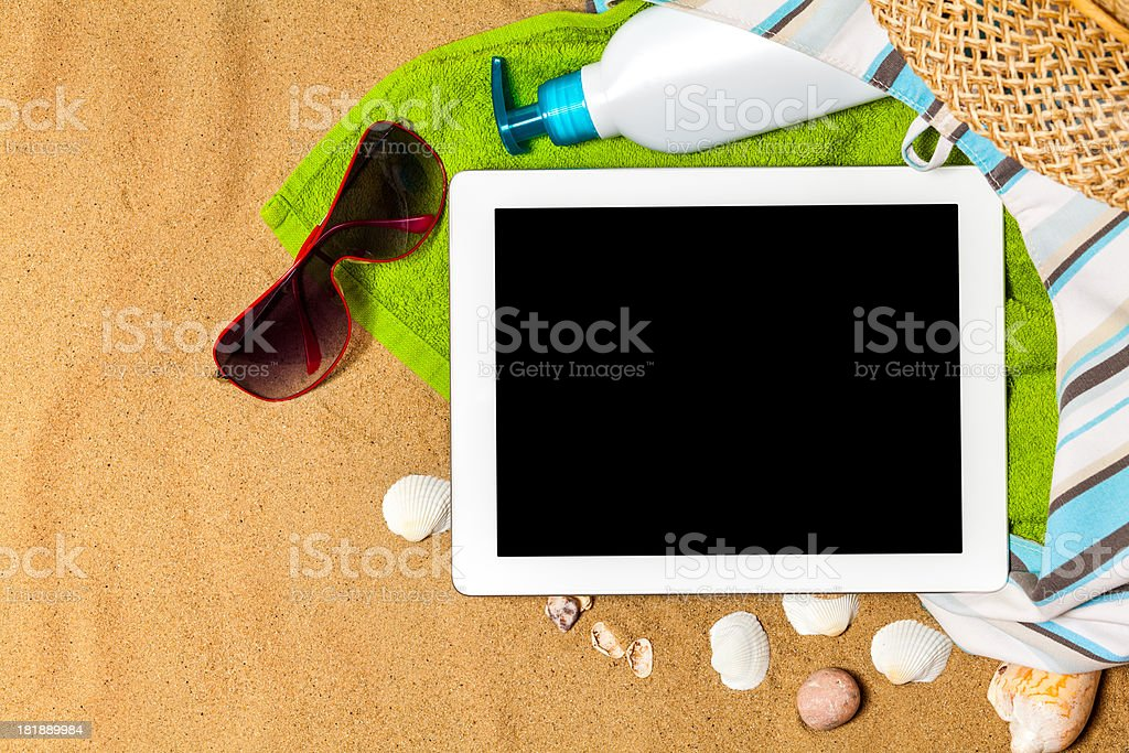 Digital Tablet on beach royalty-free stock photo