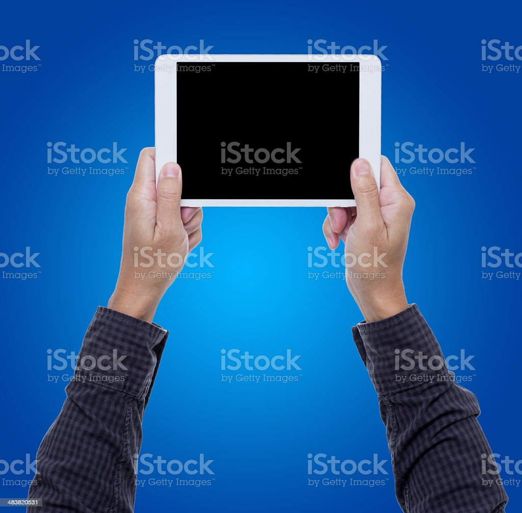 Digital tablet on businessman hands with blue background royalty-free stock photo