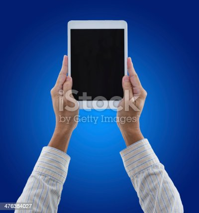 899410700 istock photo Digital tablet on hands with blue background 476384027