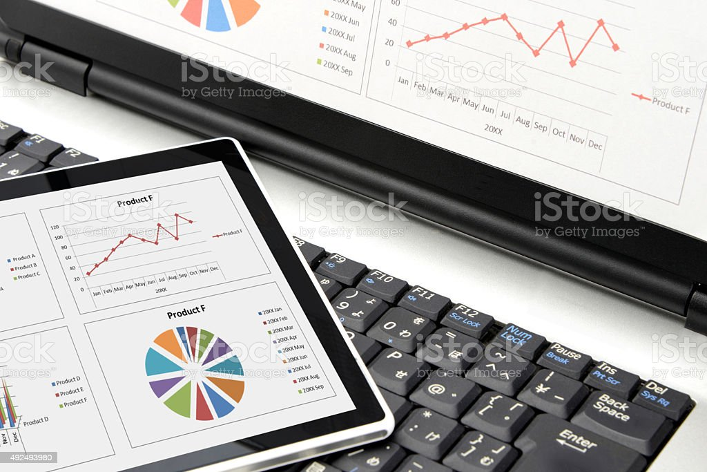 Digital tablet on personal computer stock photo