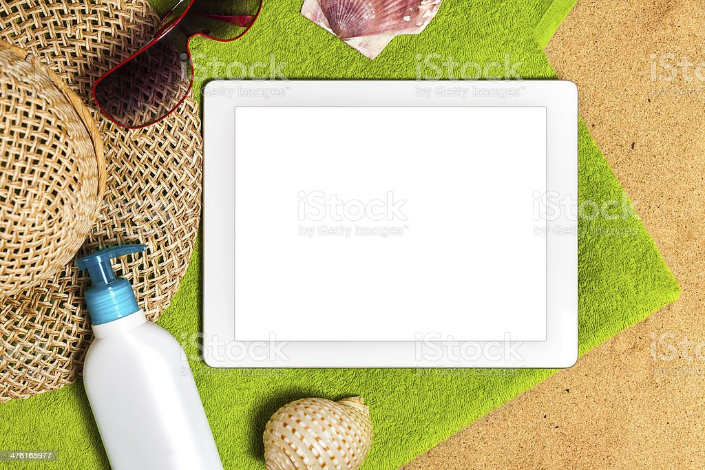 Digital tablet on sand royalty-free stock photo