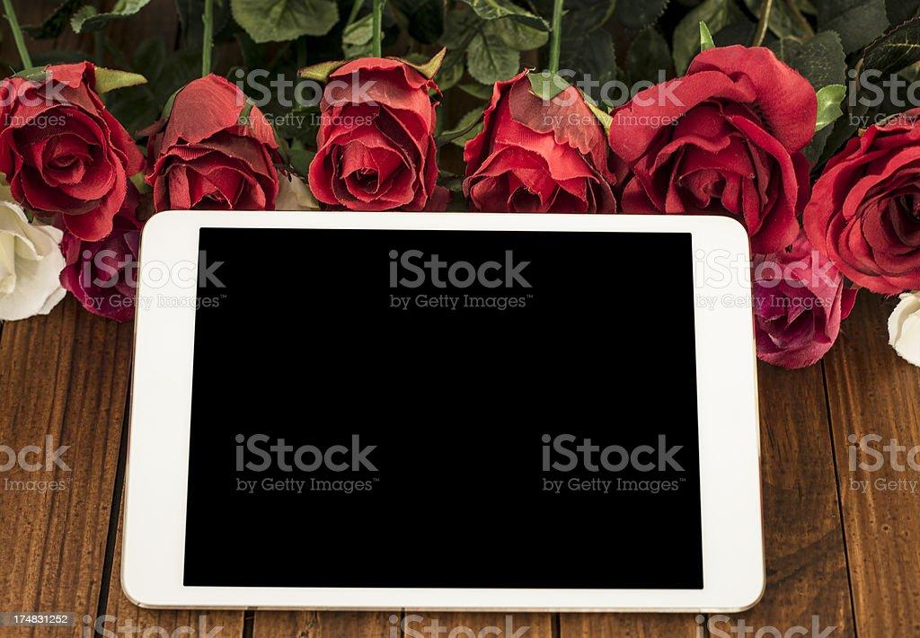 Digital tablet on St. Valentine decoration background royalty-free stock photo