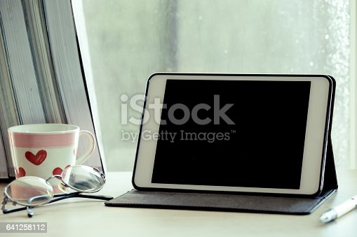 istock Digital tablet on table in the workplace 641258112