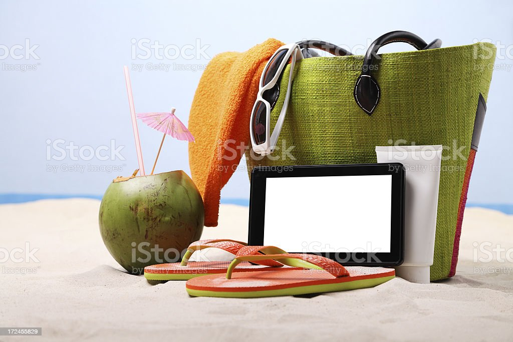 Digital tablet on the beach royalty-free stock photo