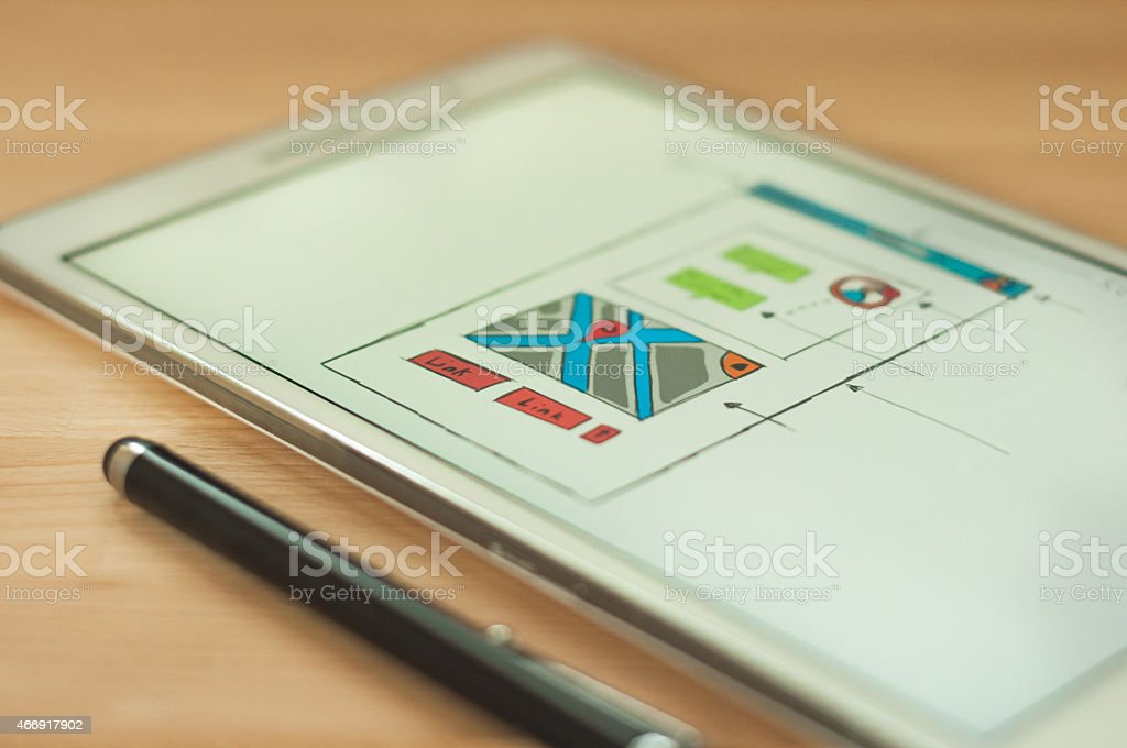 Digital tablet on wooden desk with stylus stock photo