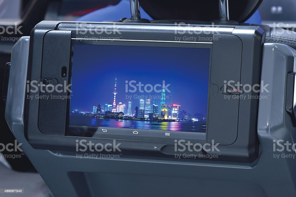 Digital Tablet PC in the car seat back headrests stock photo