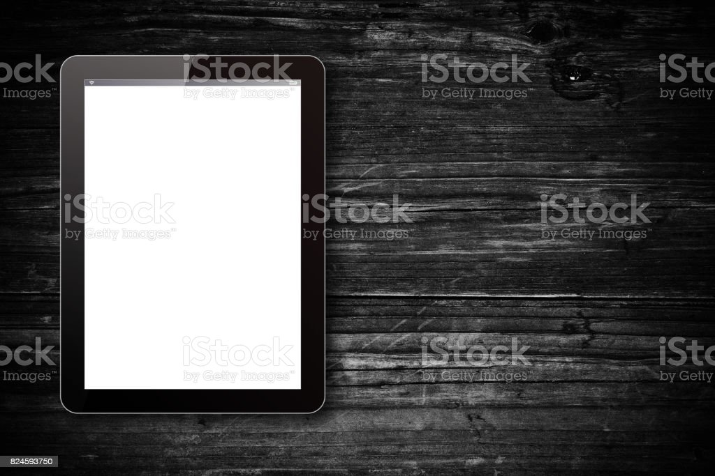 Digital tablet pc on wood background stock photo
