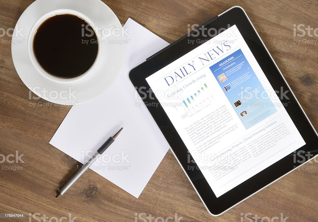 Digital Tablet PC With News On Desk (XXXL) stock photo