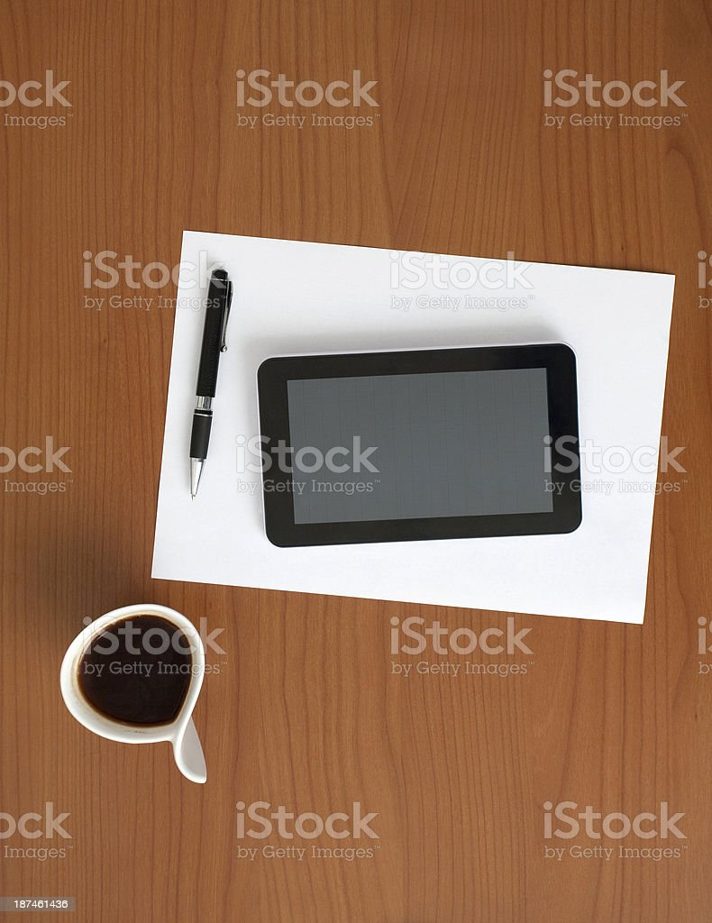 Digital Tablet, Pen, Paper and Coffee on the Table royalty-free stock photo