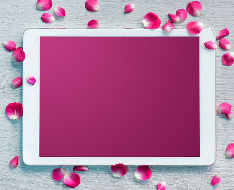 Digital tablet, pink screen with small petals