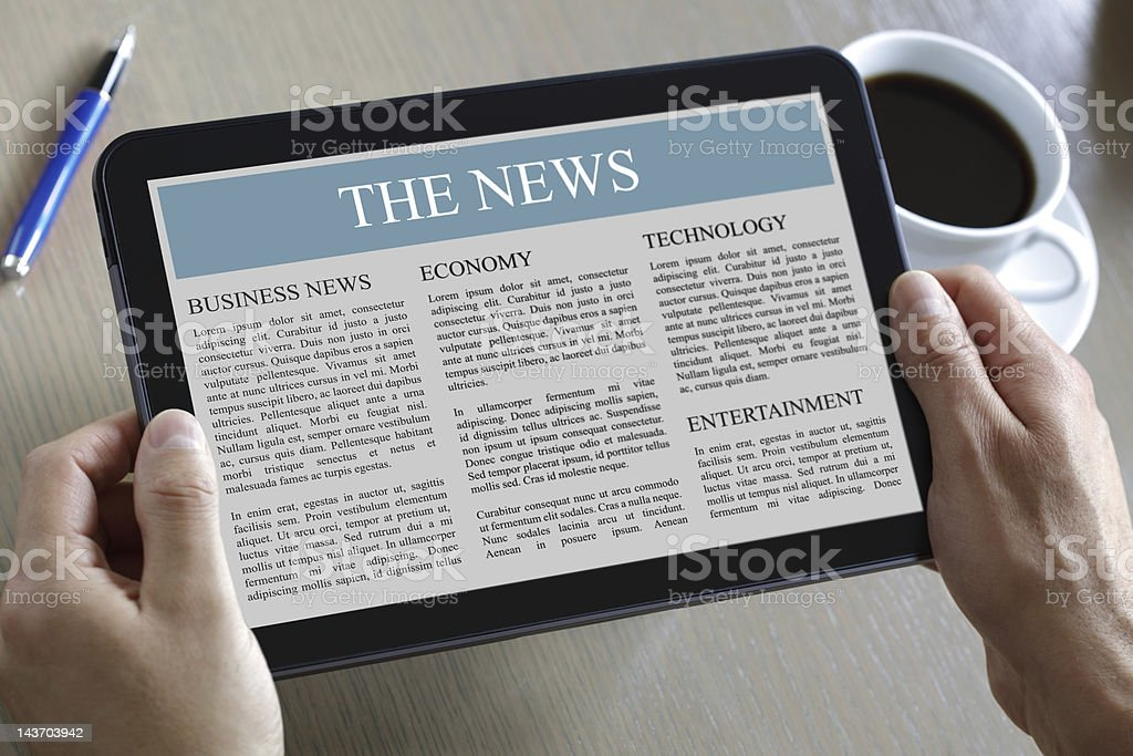 Digital tablet showing news stock photo