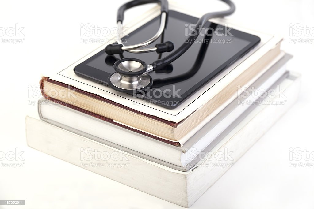 Digital tablet, stethoscope and books royalty-free stock photo