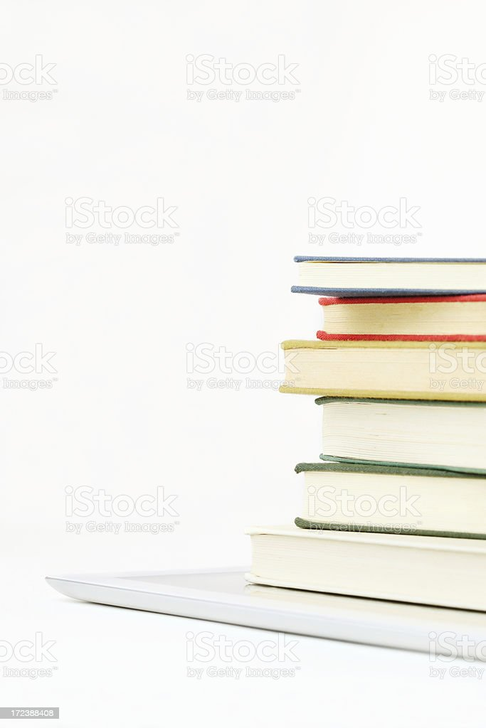 digital tablet under books royalty-free stock photo