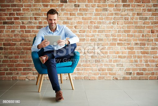 istock Digital tablet used by handsome man 592655180