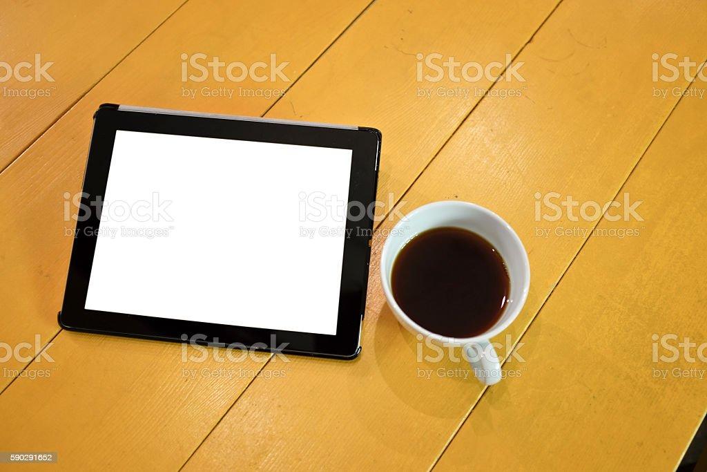 Digital tablet with a cup of coffee royaltyfri bildbanksbilder