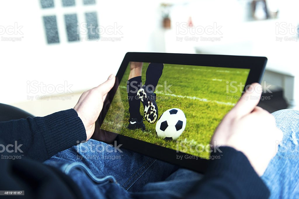 Digital tablet with an image of a soccer match stock photo