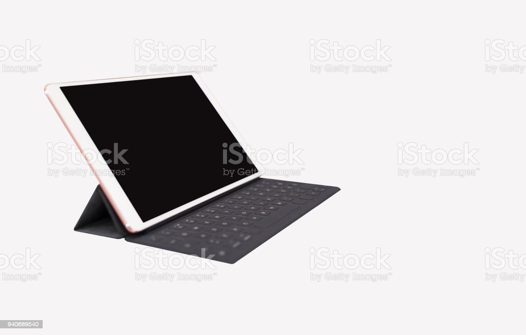 Digital tablet with black blank screen and keyboard shown on isolated white background stock photo