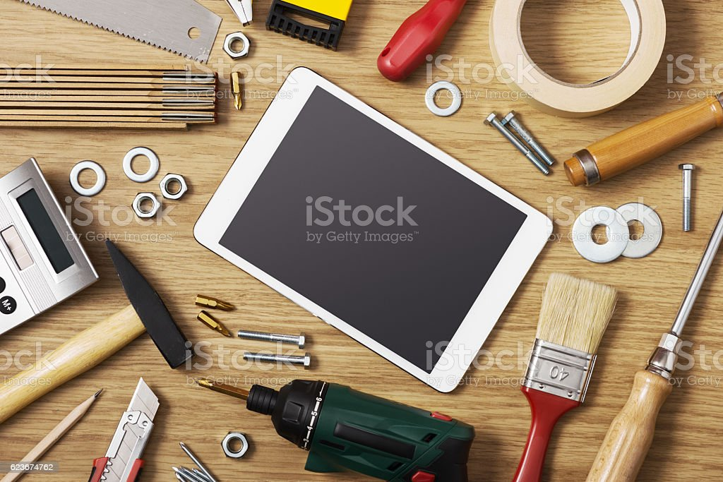 Digital tablet with DIY tools stock photo